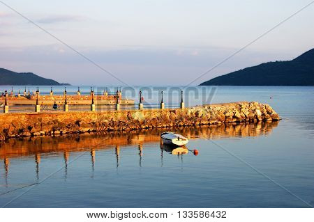Embankment of Herceg Novi and its reflection (Montenegro)