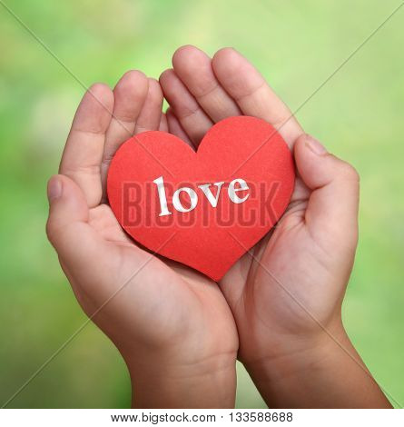 child holding heart in his hands, offering love