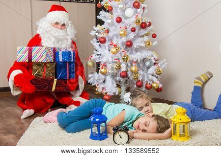 Santa Claus Brought Gifts For New Year's Eve And Softened Faces Of The Two Sleeping Sisters