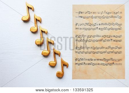 Music notes and sheet of notes on white background