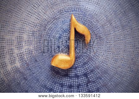 Music note on metal background