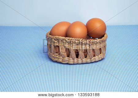 Eggs in a basket on fabric background