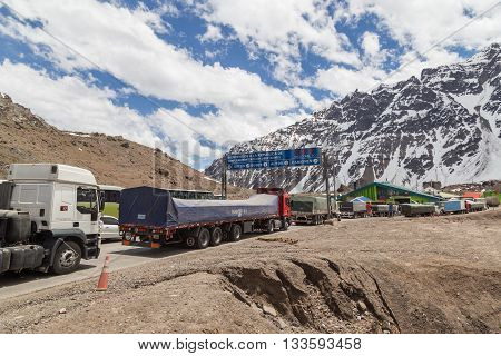 Las Cuevas, Argentina - November 25, 2015: Trucks waiting in line to cross the border from Argentina to Chile
