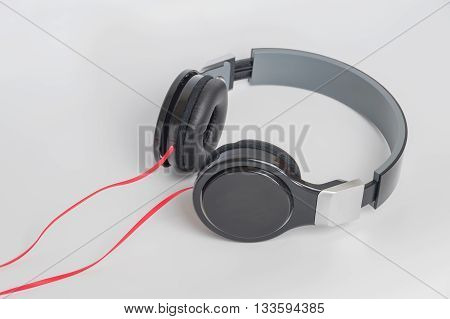 music concept - headphones on white background,earphone close-up