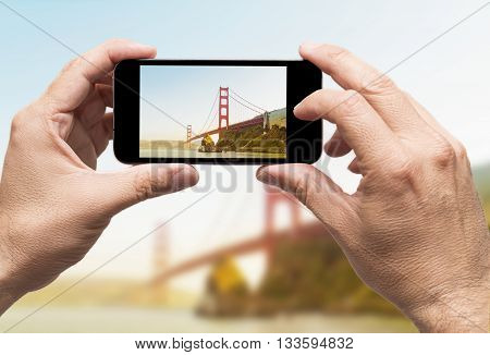 Golden Gate taking picture with smart phone