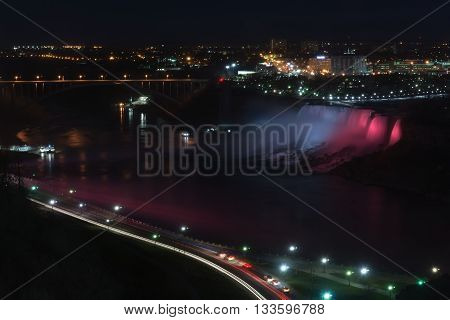 The American Falls are lite up with red white and blue.