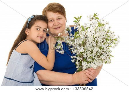 Little granddaughter tenderly embraces her old grandmother - Isolated on white background