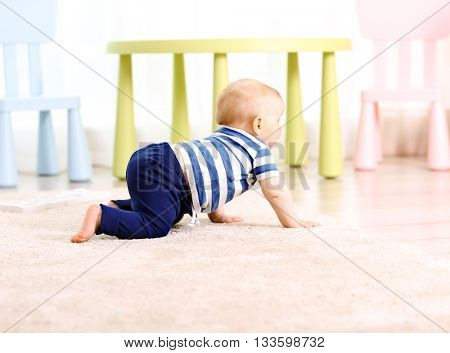 Adorable crawling baby on a floor