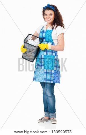 Young housewife with lots of discarded paper, isolated on white background