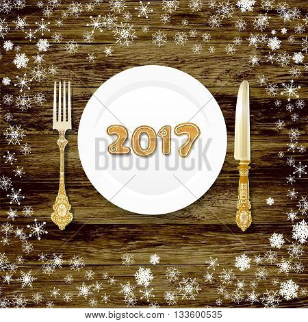 New Year's table in 2017. cutlery on a wooden table