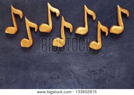Music notes on dark grey background