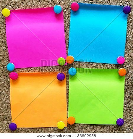 colorful sticky notes on cork bulletin board
