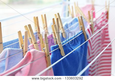 Drying baby clothes, close up