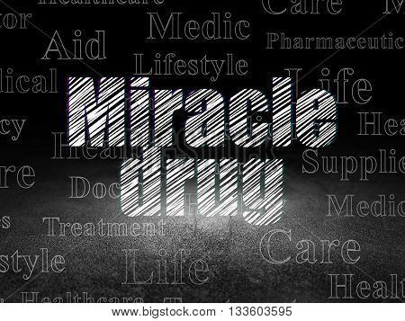 Medicine concept: Glowing text Miracle Drug in grunge dark room with Dirty Floor, black background with  Tag Cloud