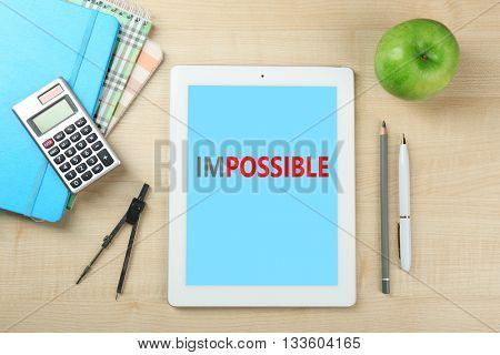 Word impossible transformed into possible on tablet-pc screen and office supplies