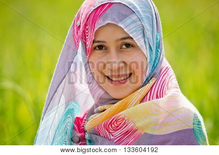 Muslim woman playing on paddy field in a village at Indonesia