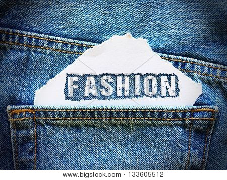 fashion word on white paper in the pocket of blue denim jeans