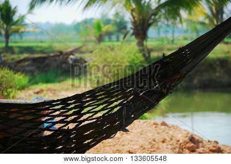 Comfortable traditional hammock in the countryside of Roi Et ISAN Thailand