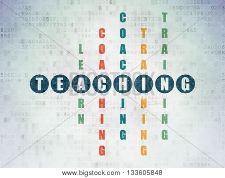 Studying concept: Painted blue word Teaching in solving Crossword Puzzle on Digital Data Paper background
