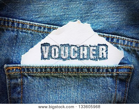 voucher word on white paper in the pocket of blue denim jeans
