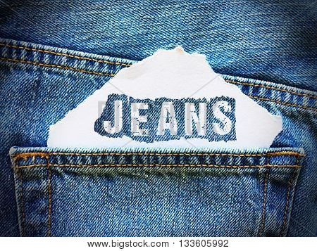jeans word on white paper in the pocket of blue denim jeans