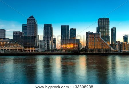 Canary Wharf across the River Thames at dusk London United Kingdom