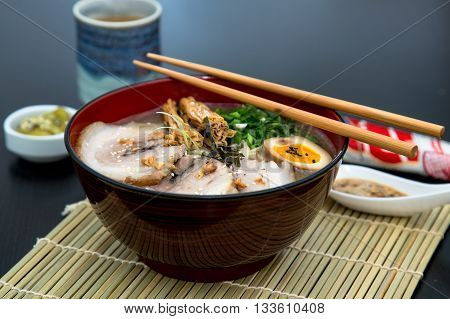 japanese tonkotsu ramen, pork bone broth noodles.