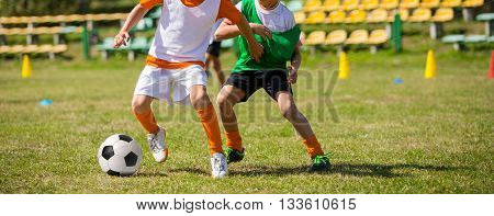 Soccer football game match for children. Kids playing training and football soccer tournament