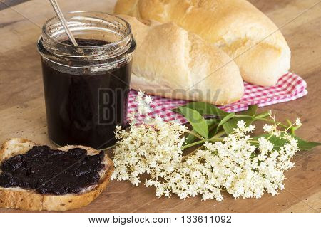 Elderberry Marmalade Spread On Bread And Flowering Branch