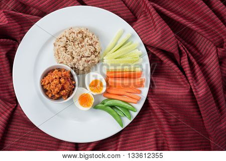 Food series : Spicy chicken and tomato dip, served with brown rice and fresh vegetable , Thai foods, northern style