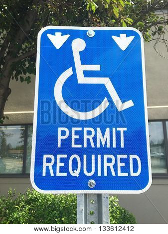 blue Handicapped Parking Sign in front of mall