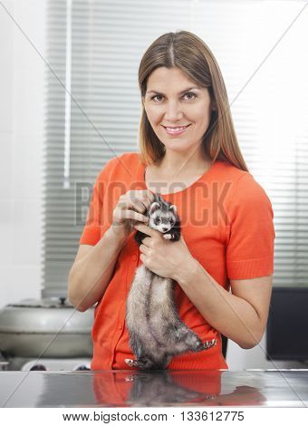 Confident Mid Adult Woman Holding Weasel
