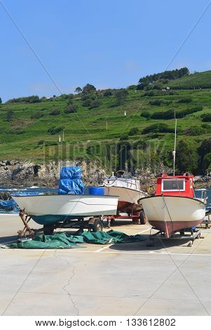 Colorful boats in the sea port in Galicia, Spain. Photo taken on June 6th, 2016