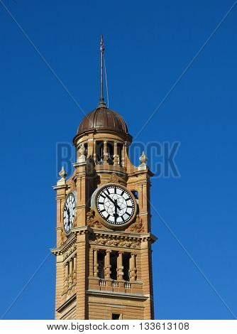 Old building in Sydney. Clock tower of the railway Central Station.