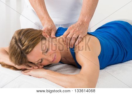 Close-up Of Person Giving Massage To Mature Woman