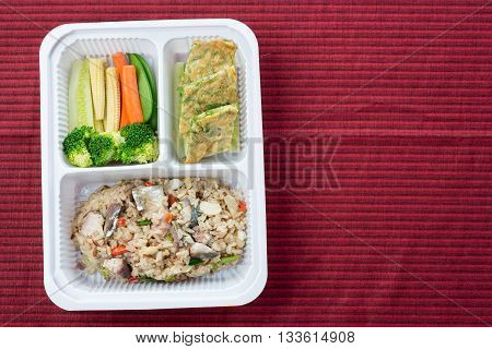 Foods series : Fried rice with mackerel fish served with fresh vegetable and acacia pennata omelet, Thai food