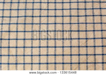 Old cross hatched blue and tan dish towel