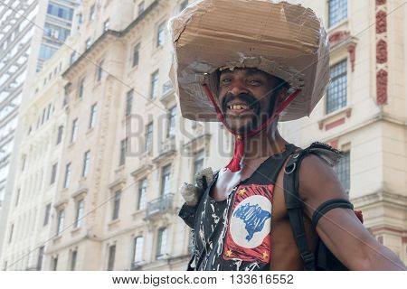 Sao Paulo - April 30, 2016: Man With Cardboard Hat And Vest With The State Flag Stylized Sp Center I