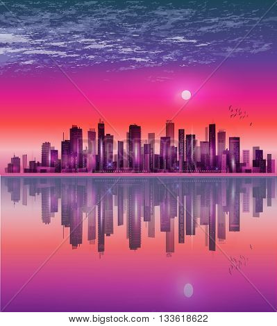 Urban Night City Skyline In Moonlight Or Sunset, With Reflection In Water And Cloudy Sky