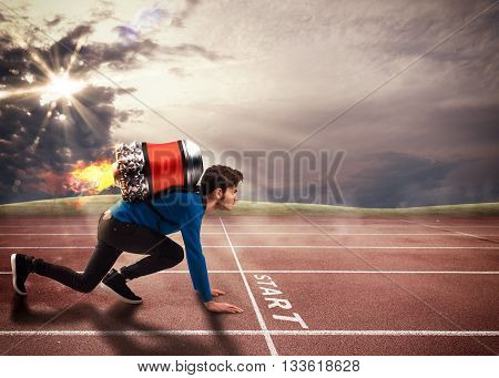 Boy with rocket on his back on running track