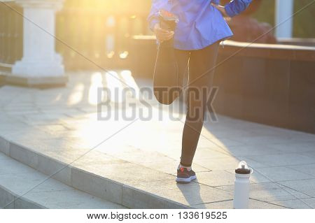 Running Stretching - Runner Wearing Smartwatch.