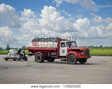 Myeik Myanmar - June 8 2016: Due to lacking road and railway infrastructure Myanmar relies heavily on air transport for travelling. Technology is often basic like the refueling gear at Myeik Airport in Tanintharyi Region.