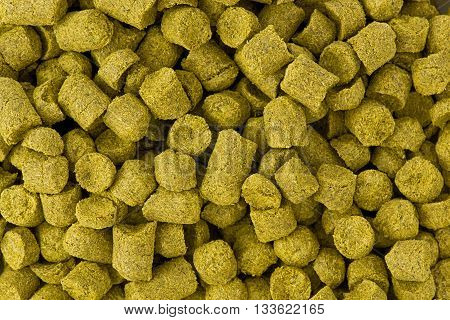 Background texture of a pile of pellet hops.