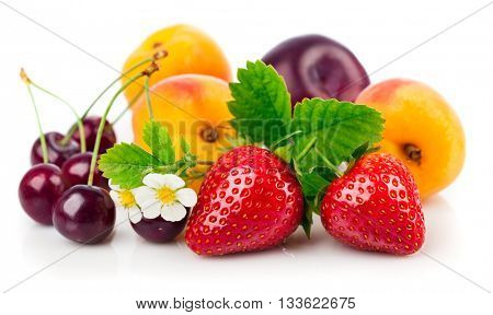 Fresh berries and fruits in still life with green leaves strawberry apricot cherry plum isolated on white background