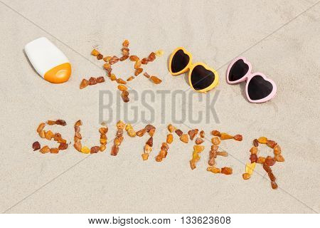 Shape Of Sun And Word Summer, Sunglasses And Sun Lotion On Sand At Beach, Sun Protection, Summer Tim