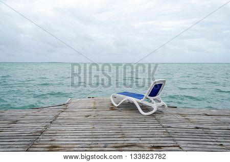 Empty beach chair on the dock in Cayo Guillermo - Ciego de Avila Province, Cuba.