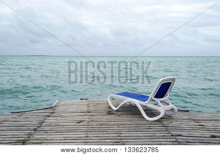 Empty beach chair on the dock in Cayo Guillermo - Ciego de Avila Province, Cuba.