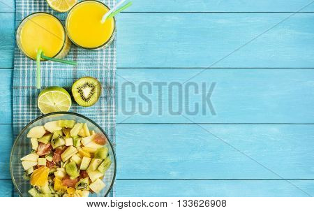 citrus fruit cut half on a blue table top view