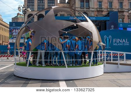 Milan Italy - May 25 2016: UEFA Champions League 2016 Real Madrid-Atletico Madrid play in the final. Volunteers are trained in the Piazza del Duomo. Volunteers are in the studio in the form of a soccer ball.
