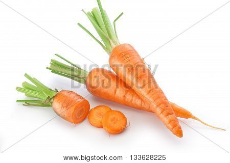 Fresh raw whole and sliced carrots on the white background